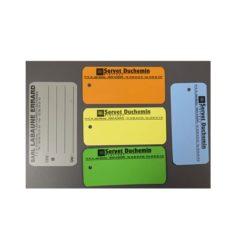 """Étiquettes PVC de différentes couleurs et formats imprimées au nom de """"Servet Duchemin""""."""