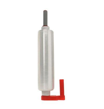 Ici vous pouvez voir un dévidoir pour film rouge à la verticale, une bobine de film transparente est dessus mais elle est encore fermé.